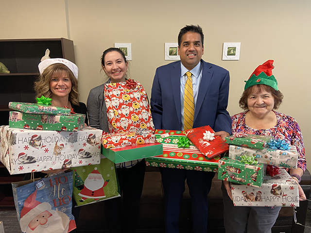 The Rochester office participated in Cameron Ministries' Adopt-a-Family program during the holiday season, donating gifts for families living in poverty.