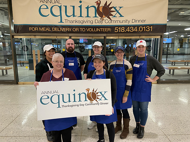 Albany attorneys and staff who volunteered to help Equinox sort and organize ingredients for thousands of meals for its annual Thanksgiving Day community dinner.