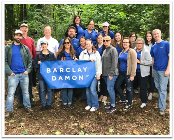 The Rochester office annual Community Day took place at Washington Grove, with attorneys and staff helping with trail maintenance and removing invasive species such as lily of the valley, honeysuckle, and Norway maples.
